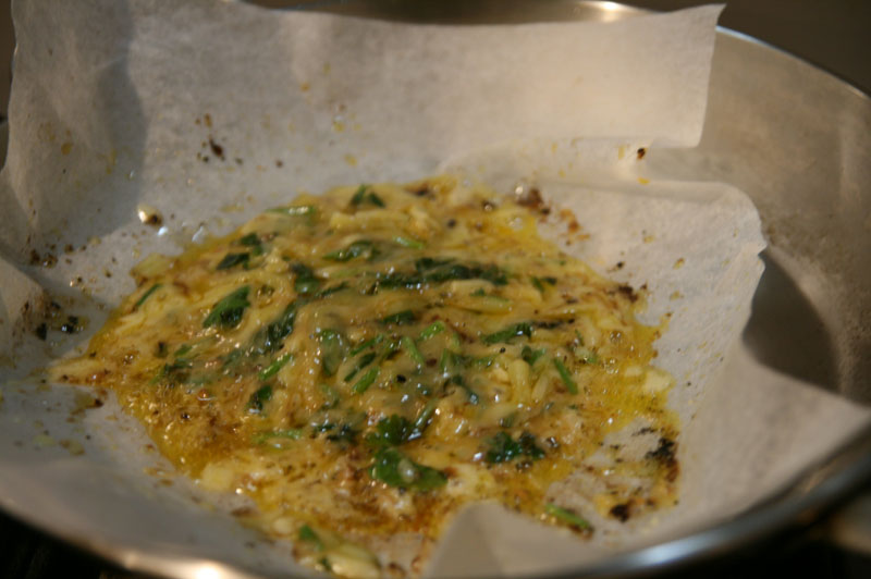Cheesed and coriander fried until melted bubbling at the edges.